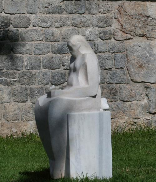 Statue of person sitting down